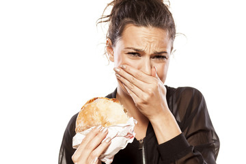 beautiful girl is disgusted by her sandwich