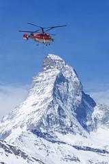 Helicopter flew over Matterhorn peak in Zermatt, Switzerland