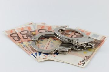 Handschellen auf Geldscheinen