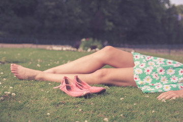 Bare legs of a woman in the park