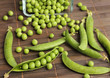 green peas pods on wooden table
