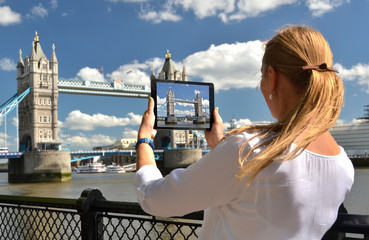 Tower bridge on the screen of a tablet