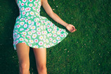 Fototapety Young woman in dress lying on gerass