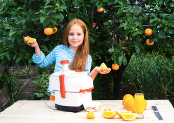 Girl squeezes out juice using a juicer