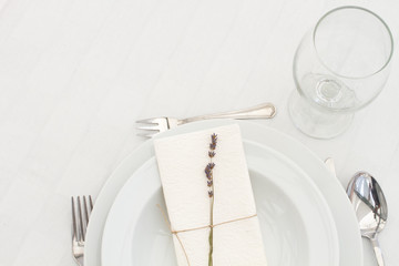 dining table setting with lavender - closeup