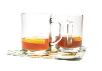 isolated cups of tea with a lemon