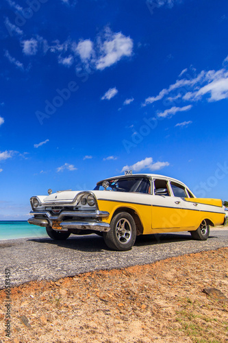 Classic taxi parked near the beach in Vinales, Cuba - 66583457