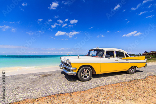 Classic taxi parked near the beach in Vinales, Cuba - 66583471