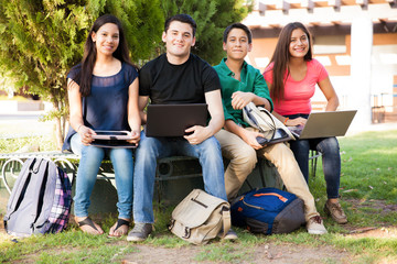 Happy students using technolgy