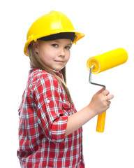 Girl as a construction worker with paint roller