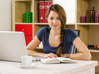 Student studying in front of laptop