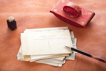 vintage red leather ink blotter  with retro post cards on leathe