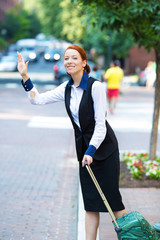 Happy businesswoman hails for taxi cab standing outside