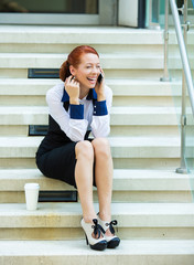 Happy smiling businesswoman talking on mobile cell phone