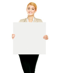 Portrait of a young woman holding blank card - over white