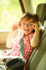 Transportation. Little girl child kid sitting in the car