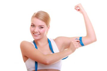 Fitness woman fit girl with measure tape measuring her biceps