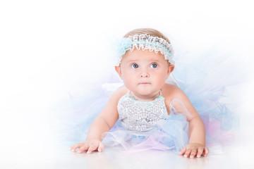Stylish infancy, babe in lush skirt