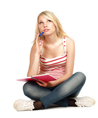 female student sitting on floor.