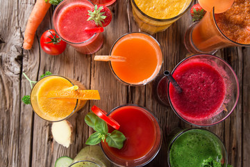 Fresh juice, healthy drinks on wooden table.