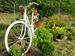 Model of an old bicycle equipped with basket of flowers