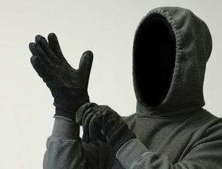 Scary Person Puts on Gloves