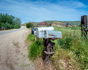 Rural road with a barn and mail boxes