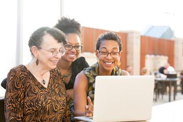 Women watching laptop