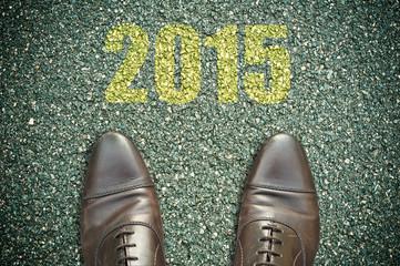 concept pied sur la route et message - 2015
