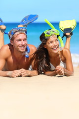 Beach couple having fun snorkeling on vacation