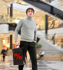 Ыmiling man n with shopping bag