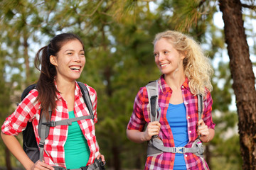 Healthy lifestyle women laughing hiking in forest