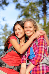 Girlfriends - happy young women hiking portrait