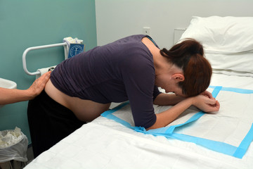 Pregnancy - pregnant woman having contraction