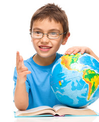 Little boy is holding globe