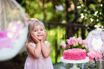 Little girl celebrate Happy Birthday Party with rose decor in th