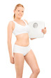 Woman in cotton underwear holding a weight scale