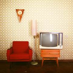 Vintage room with wallpaper, old fashioned armchair, retro tv, p
