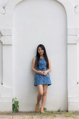 Asian girl and white wall