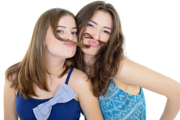 Portrait of a two teen girls have fun and make faces with mousta