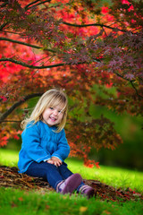 beautiful natural autumn garden and little funny child
