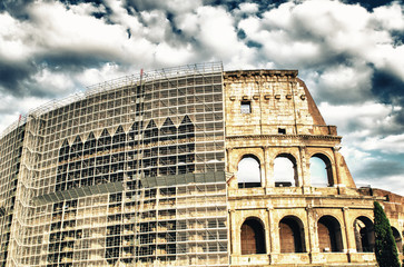The Colosseum in Rome with restore works in progress on the faca