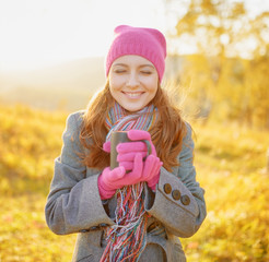 Young woman enjoying the fall season. Autumn outdoor portrait