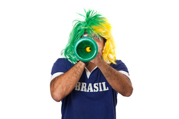 Brazilian fan blowing a vuvuzela