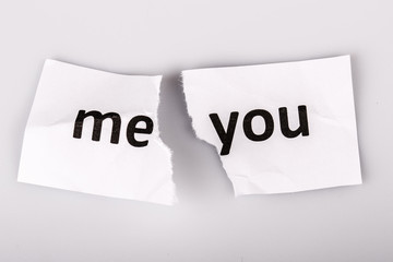 """ME YOU"" words written on torn paper"