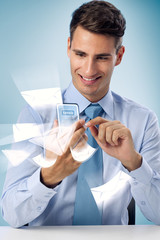 sending mail - Smiling man using futuristic phone