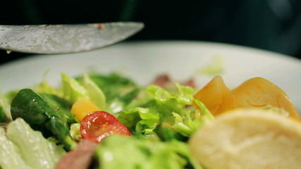 Someone eating healthy food, closeup, steadycam shot