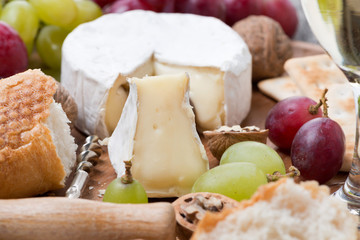 Camembert, grapes and fresh baguette, close-up