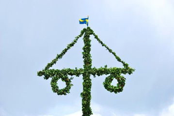 Swedish flag pole fixed to midsummer