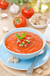 cold tomato soup gazpacho with basil in a bowl vertical